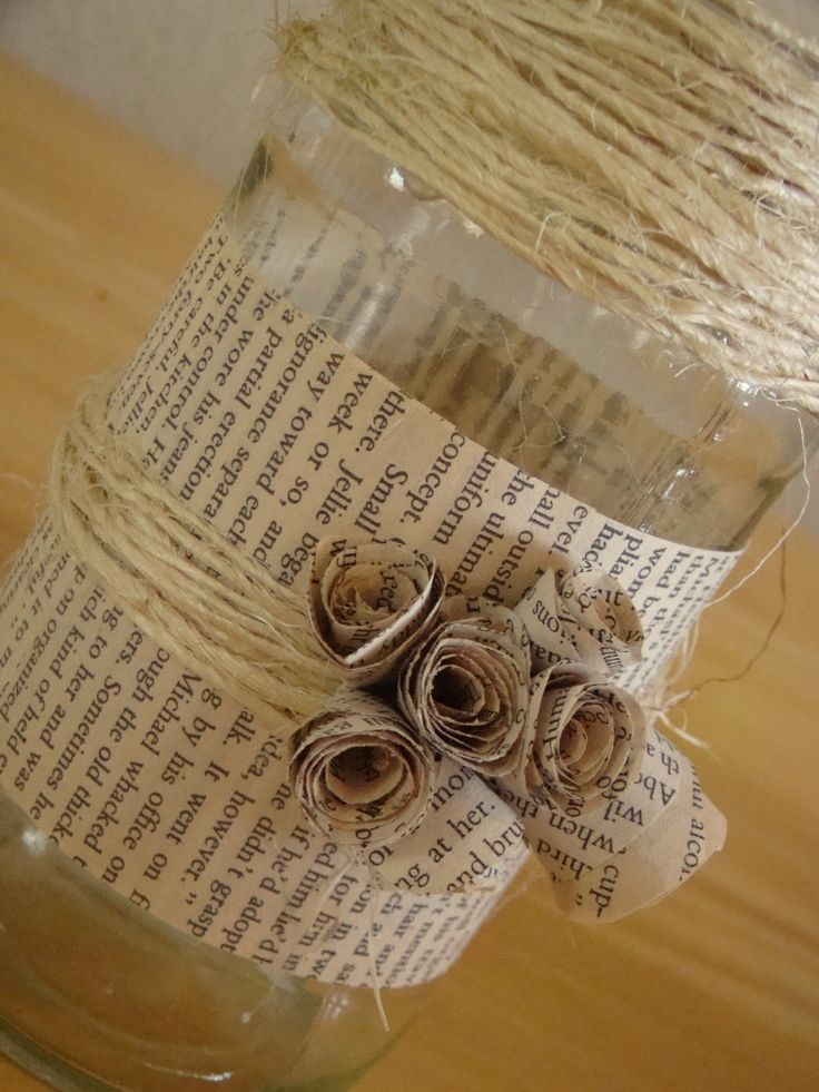 glass jar for pens ect with book page design.