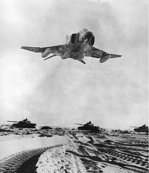 F-4E of the Israeli Defence Force overflies tanks during the Yom Kipper War 1967.