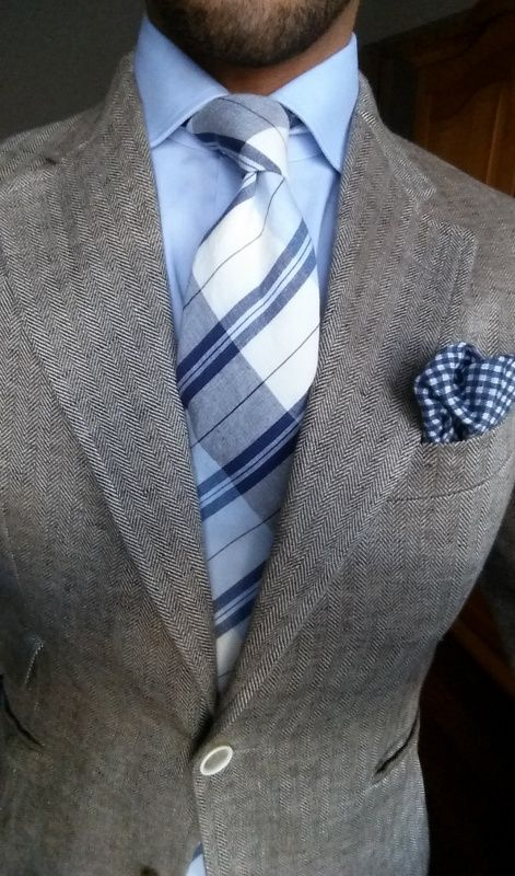 Very nice. Grey wool blazer with light blue and navy shirt, tie and plaid pocket square.
