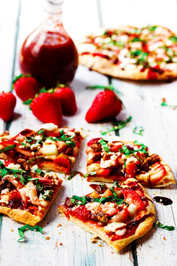 Thin , slightly crunchy crust topped with a sweet, homemade strawberry sauce, loaded with juicy strawberries, fresh buffalo mozzarella, maple roasted pecans,  tangy balsamic reduction and finally sprinkled with a generous handful of fresh basil.  Absolutely over the top incredible. #dessertpizza #appetizer