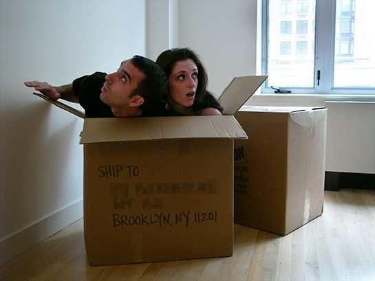"""We Moved  We announced ourselves as first-time homeowners with this silly photo. It was the first shot we took, and both of us were completely inside that box. No missing sides or Photoshop trickery here!"""
