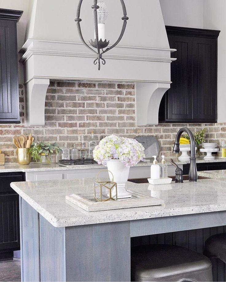 Pretty modern rustic kitchen with brick style backsplash