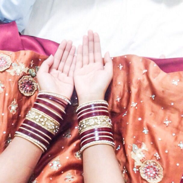 Maroon and golden bangles