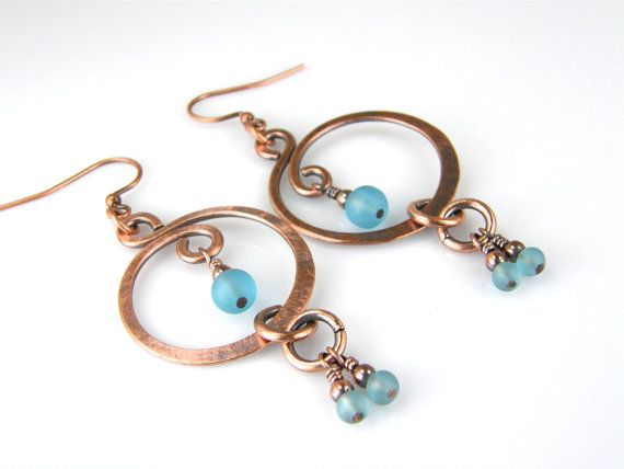 "♦ Copper Wire Earrings, Blue Beaded Copper Earrings, Womens Handmade Boho Earrings, Dangle Earrings. ♦ Blue sea glass & copper wire earrings, Antiqued copper wire earrings, rustic hammered copper wire earrings. Copper earrings made from pure 14 Gauge copper wire. These earrings are oxidized for a warm, aged or antiqued look and hand polished for contrast. Rustic meets elegance in these everyday copper earrings. Blue glass beads look and feel like sea glass.  ♦ Earrings measure 2"" long to ..."