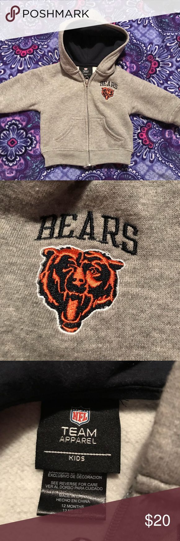 Chicago Bears zip up hoodie Chicago Bears zip up hoodie with two small front pockets.. working zippers. No stains. Gently used. Still soft inside. Bears logo on front. Grey zip up with Navy inside hood. Size 12 months. Football  Chicago sports. NFL team apparel Shirts & Tops Sweatshirts & Hoodies