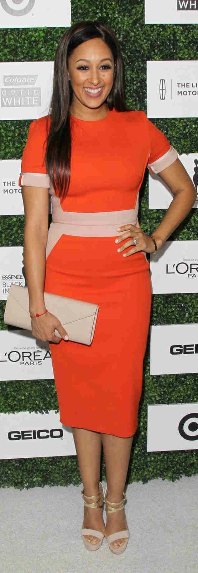 Tamera Mowry- Housley. I like this little tangerine dress