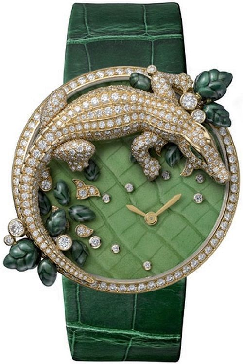 Les Indomptables de Cartier brooch watch. Made of 18-carat yellow gold, with diamonds and emeralds. #WomensFashion #Brooches