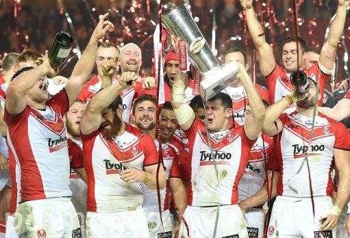 St Helens Paul Wellens lifts the Super League trophy after his teams win against Wigan Warriors, during the First Utility Super League Grand Final match at Old Trafford, Manchester.