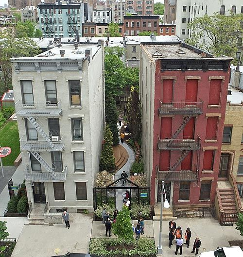 The New York Restoration Project transformed an abandoned alley between two buildings into a beautiful area where children can interact with nature.