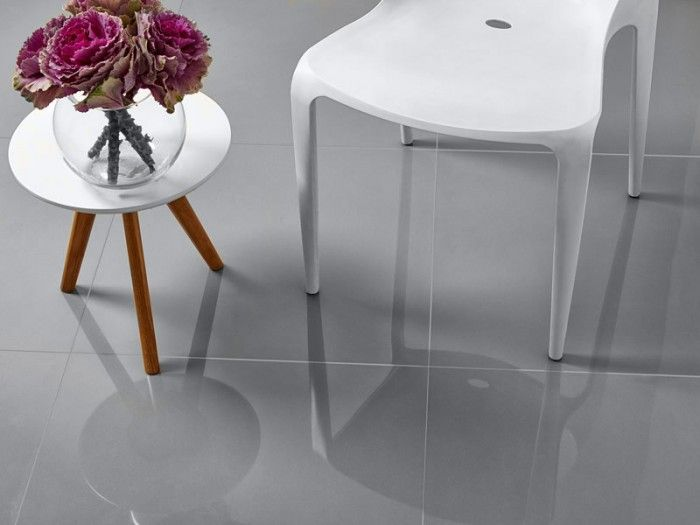CTM - Super Light Grey Nano Floor Tile. The highly reflective surface of the polished porcelain tiles adds depth and dimension to a room. Because they are manufactured mainly in larger sizes, their application is suited to larger floor areas. Polished porcelain tiles are available mostly in neutral tones. They add a striking complement to more modern, uncluttered interiors,