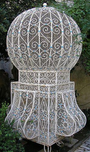 Old fashion white metal birdcage.