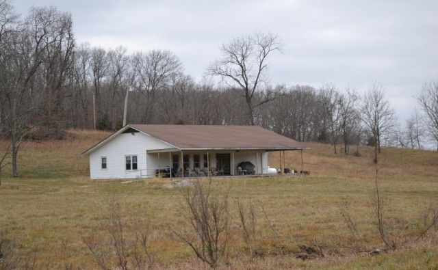 Farm with Timberland for Sale in Southern Missouri!! This is 345 Surveyed Acre Ranch with 3 bedroom, 1 full, 2 half bath home with covered country front porch and 48x48 metal shop building with cement floor! Home sits back into property for privacy. Acreage is fenced & cross-fenced, has a 300 plus ft. drilled artesian well, 2 acre stocked, spring-fed lake, 4 ponds. The acreage has pasture and marketable timber. Excellent hunting property with deer stands, food plots in Willow Springs MO