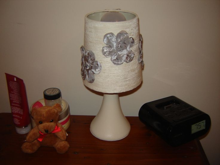 changed the color of our bedside lamps from red to cream with a bit of curtain fabric, and paint