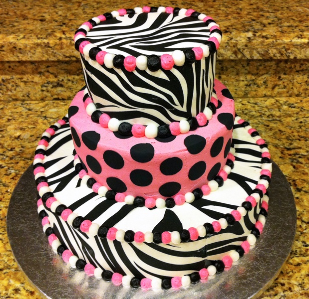 Zebra Print Birthday Cake - Using the new Wilton frosting sheets on a buttercream frosted cake. NOT the most ideal thing for an entire side of a cake (the zebra print). I had to use black food coloring to blend the sheets together and merge the lines. Still not as smooth as I'd like, but it turned out ok and it was a learning experience.