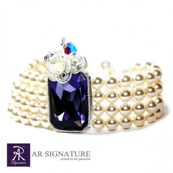 Queen Lantana Braclete - Swarovski Jewelry by AR Signature.  Queen Lantana Bracelete, Hancrafted by AR Signature,Jewelry made with Genuine Swarovski® Crystal and Plated wire from USA.  With Tanzanite Color Crystal and Cream Pearls from Swarovski, combine with AR Signature luxurius design and high quality material, This bracelete will definitely makes the wearer look like a queen.  Color :  Crystal : Tanzanite  Pearls : Cream