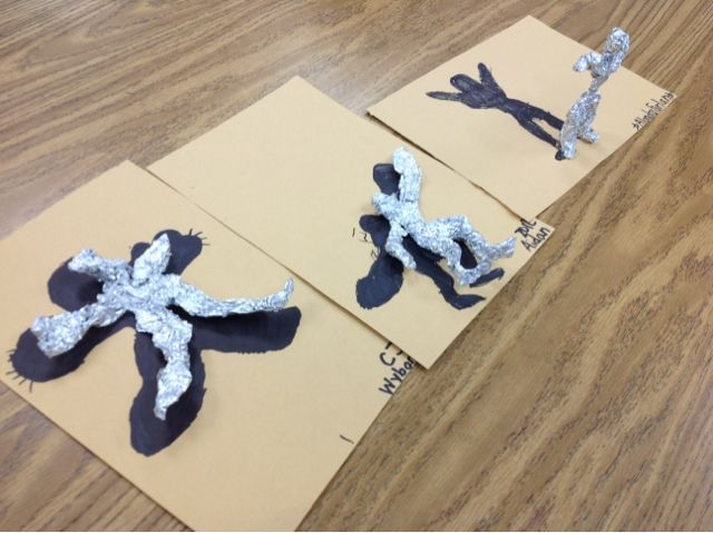 Draw figure first, then create foil sculpture to match.  have sculpture stand up.
