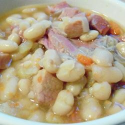 Basic Ham and Bean Soup Allrecipes.com.  Used a ham bone and  white kidney beans.  Replaced water with chicken stock as reviewers suggest.  AWESOME!!!