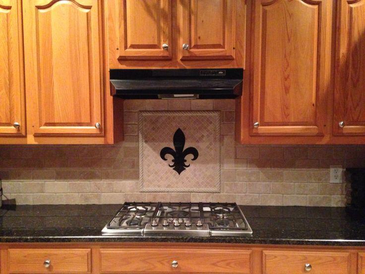 Travertine backsplash fleur de lis matches granite for Handmade kitchen decoration