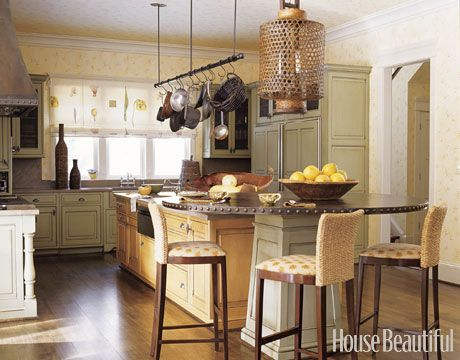 love this kitchen layout. Table built in to island