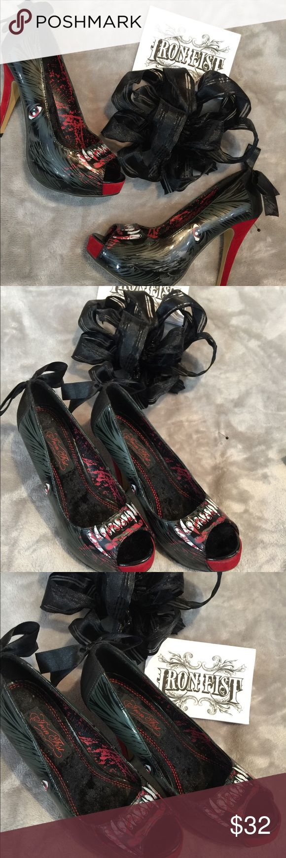 Awesome Iron Fist Heels Slightly worn excellent used condition. About a four inch heel.  Black and red with bloody teeth. And black bows on the back.  Size 8. No pets or smoke closet Iron Fist Shoes Heels