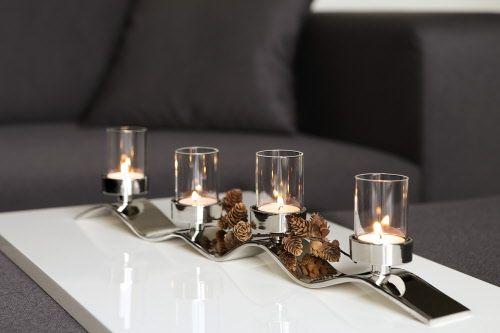 Kerzenleuchter, 4-flammig, vernickelt, für Teelichthalter (4 cm Durchmesser) geeignet, inkl. 4 Glasaufsätze  Wellenförmig zieht sich ein vernickeltes Metallband dahin, darauf ruhen  vier gläserne Teelichthalter – das ist WAVE! Hier hat Fink Living ein wirklich repräsentatives Wohnaccessoire geschaffen, das mit seinen sanften Schwüngen in metallischem Glanz alle Blicke auf sich zieht. Schön auch als Adventskranz im minimalistischen Stil – abseits des Üblichen! Die Teelichthalter gibt es in…