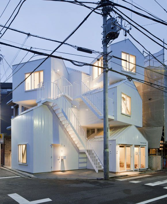 New Approaches to Apartment Living in Japan | Tokyo Apartment  by Sou Fujimoto Architect.  Sou Fujimoto devised multi-unit housing by literally stacking house-shaped units one atop the other. The topmost units are accessed by exterior staircases, like vertical renditions the narrow alleyways one finds in Tokyo.