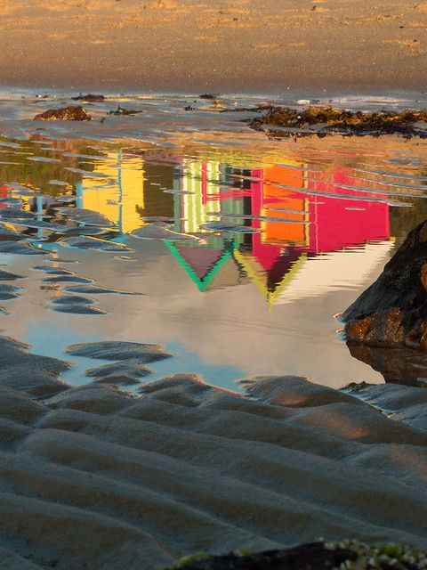 I'd like to blow this up & hang it on the wall :) love the color, the beach & the upside down of this. Fits me :)Beach hut reflections.