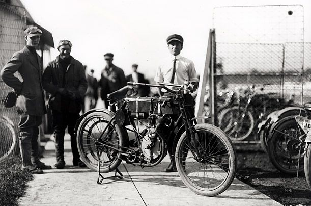 William S. Harley and Arthur Davidson with the first motor bike they ever made (1903)