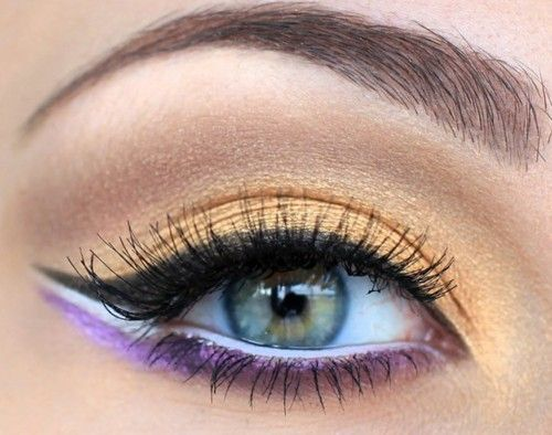 Bright Gold or Light Orange Eyeshadow~Winged eyeliner in black, white eyeliner on the water line and bright purple eyeliner on the lower lash line