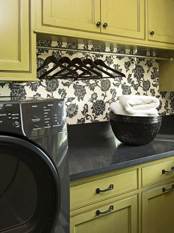 I like the idea of painting/glazing the laundry cabinets and adding some fun wallpaper