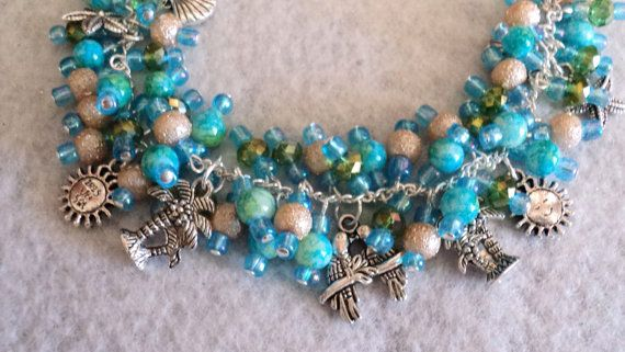 Beautiful Beach Charm Bracelet Designed With Gl And Crystal Beads In The Colors Of Creme Blue Green I Have Added Themed Charms Throughout
