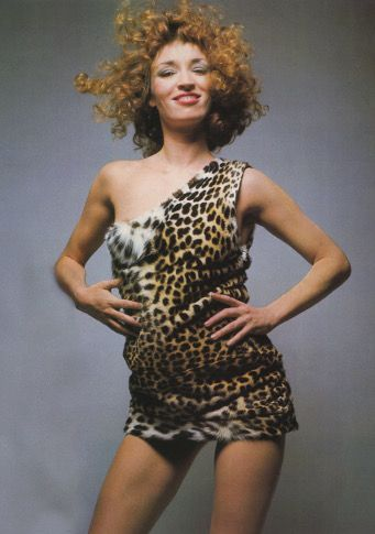 Talitha Getty by Jean-Lou Sieff in Vogue Paris april 1970. she wears Yves Saint Laurent Haute Couture mini dress in leopard skin.