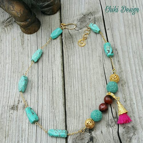 Handmade (Gold-Plated) Necklace with Agate, Lava and Turquoise Stones and Pink Tassel - Chiki Custom made unique jewelry.This handmade bracelet is crafted from the finest agate, lava and turquoise stones – tied together with a pink tassel. Also bearing a smooth golden plating, it is a delicate and fashionable piece meant to complement casual and fancy dresses.by Chiki Design