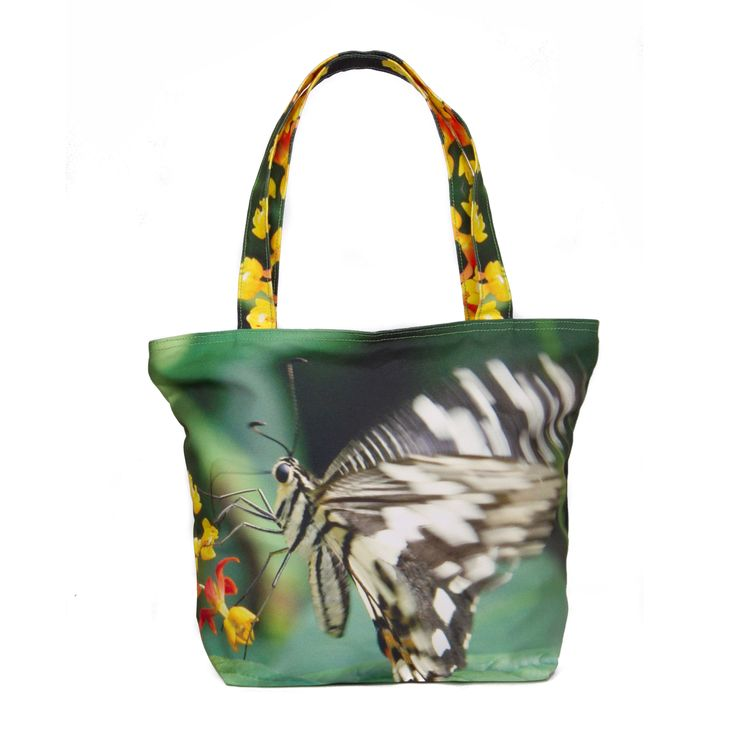 Butterfly    Butterflies have long been known for its grace and beauty, adding character to the skies with dashes of brilliant colors and symmetrical patterns. They provide life and give off spectacular movements of splendour, dancing the though wildlife to share more of its charm. This tote bag showcases a delicate butterfly perched on a flower, take the time to gaze at the dainty and delicateness of this mystifying beauty.