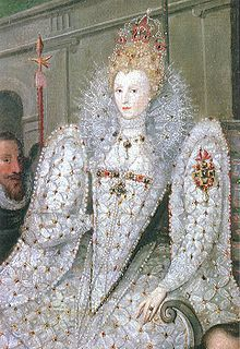 Queen Elizabeth I's  royal dress is white like the angels. The arms are so large at the shoulders that they approximate wings.