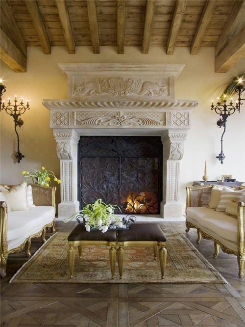 Mediterranean Living Room with Czar Flooring Custom, Hardwood floors, Exposed beam, stone fireplace, Wall sconce
