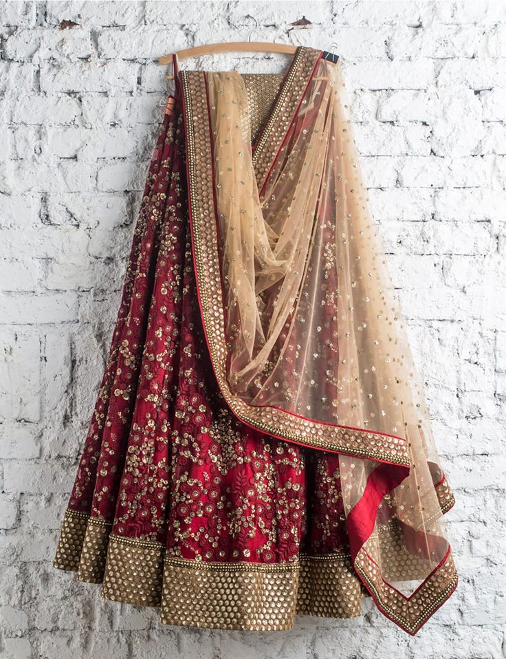 SwatiManish : Maroon lehenga with gold dupatta