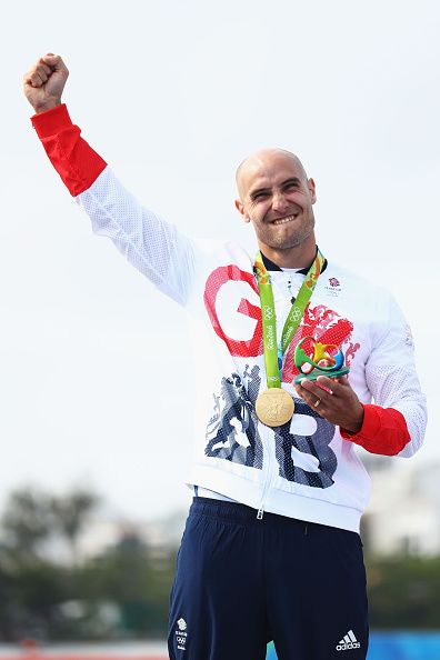 Liam Heath of Great Britain celebrates winning the gold medal in the Men's Kayak…