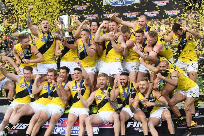 Richmond players celebrate with the premiership cup