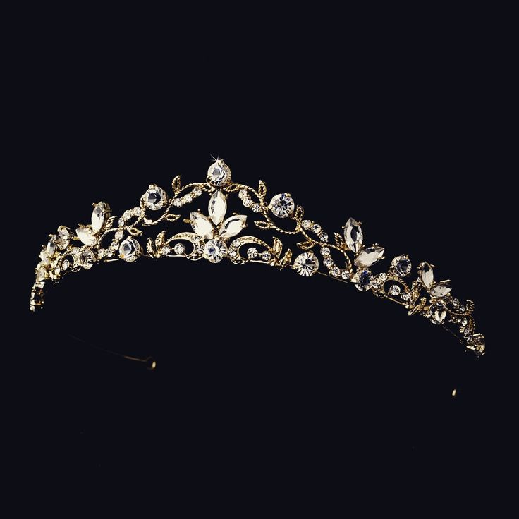 This beautiful, delicate golden headpiece is the perfect touch for your wedding day or any special occasion. Golden detailing and dozens of sparkling crystals are just the right touch of elegance. - S