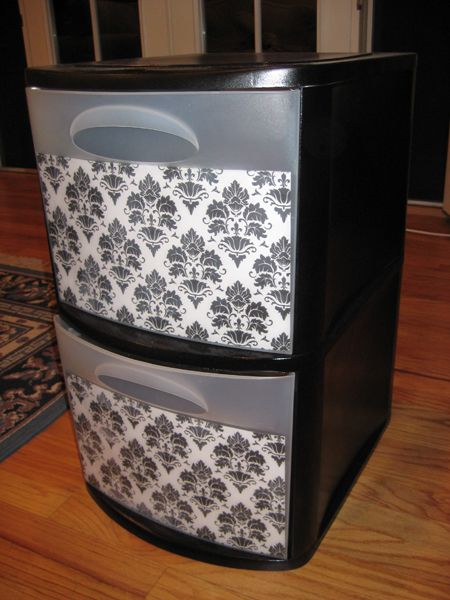 Definitely going to do this with my plastic sterilite drawers! Cheap and creative done with spray paint and scrapbook paper.