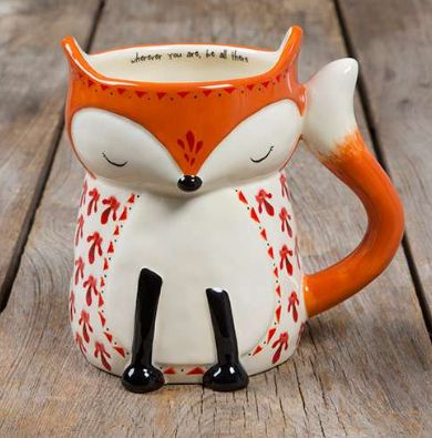 "This folk art mug will have you smiling every time you drink from it! It features an adorable fox design and the sweet sentiment, ""Wherever you are be all there"" on the inside! This hand sculpted, cer"