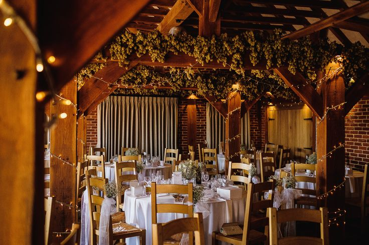 wedding breakfast set up in the barn with our fairy lights wrapped around the beams  Kent wedding venue - www.theferryhouseinn.co.uk  copyright - www.matttylerphotography.com