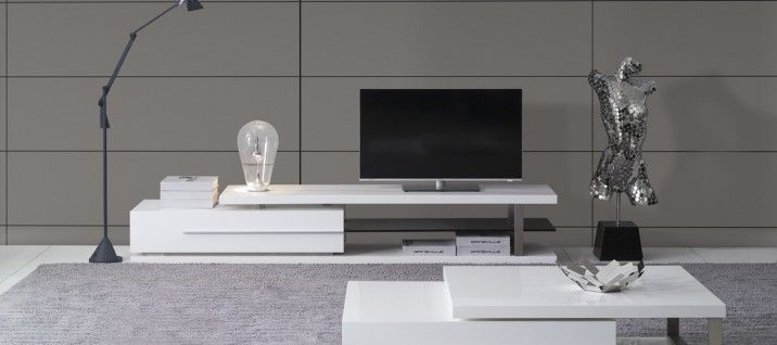 London L240 TV Unit. This brings a beautiful sense of movement into any room with a non-symmetrical design that looks like it's in the process of sliding into or out of place. Ample open space in the unit creates an airy easiness in addition to the luxurious high gloss white finish.