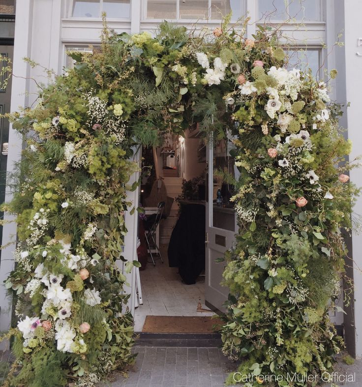 Floral arch, greenery and foliage and wedding flowers.  Special wedding class  Catherine Muller Flower School London