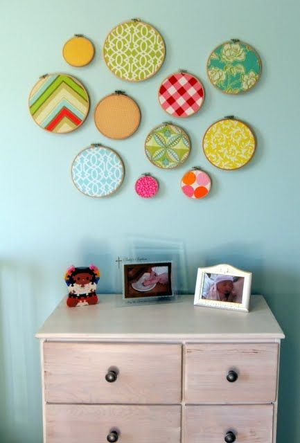 Embroidery hoop art with vintage fabrics for a perfect baby girl nursery.  Now all I need is a girl. Big boy rooms are no fun.
