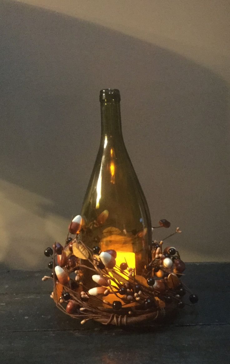 Wine bottle led light with candy corn wreath, country decor, Halloween, centerpiece, led lights, shabby chic, wine decor, bottle, upcycled by jenascreations45 on Etsy
