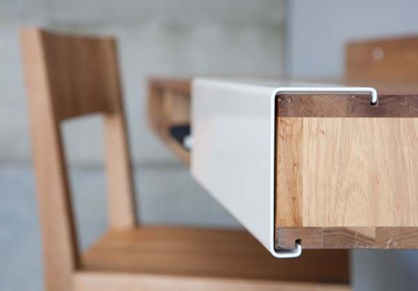 designed by MASH Studios and is part of a collection entitled The LAX Series. The desk attached to the wall makes legs useless and gives an alternative for small spaces. It also looks great and has a sliding part that hides the drawers.