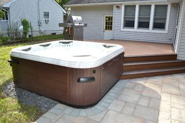 Hot Tub Bullfrog Spas with Trex deck and Cambridge paver patio traditional-hot-tubs