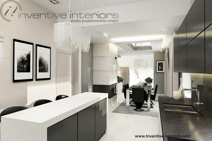 Projekt kuchni Inventive Interiors - wyspa kuchenna z grubym białym blatem